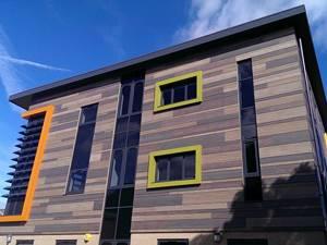 Многообразие панелей для отделки фасада коттеджей: выбираем правильно материал