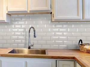 Для отделки стен на кухне обычно используют кафель